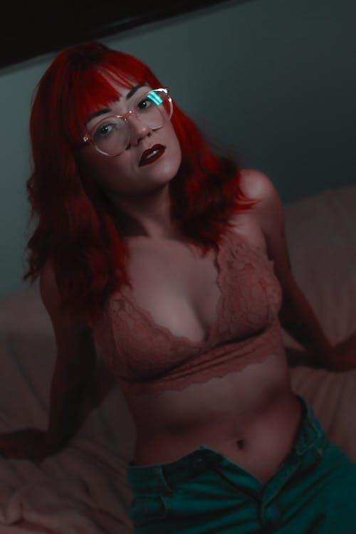 Woman in Red Brassiere Wearing Red Framed Eyeglasses