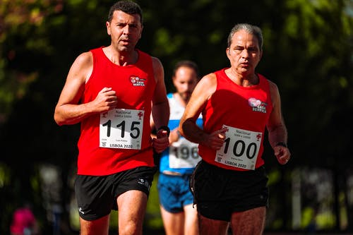 Middle aged sportsmen running during athletic contest