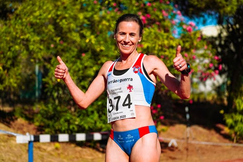 Cheerful female athlete with thumbs up after competition