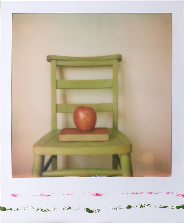 Red Apple Fruit on Green Wooden Chair