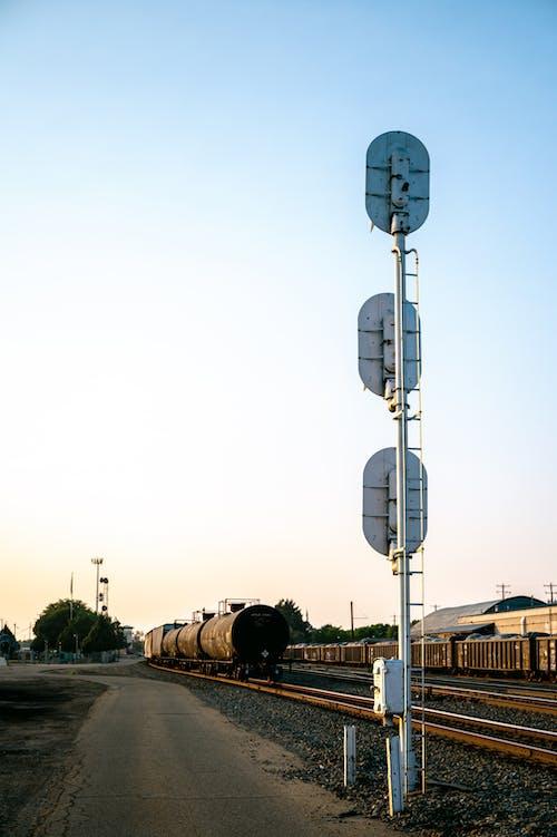 Asphalt road near railroad with trains