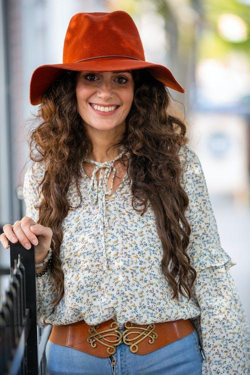 Positive stylish woman on city street