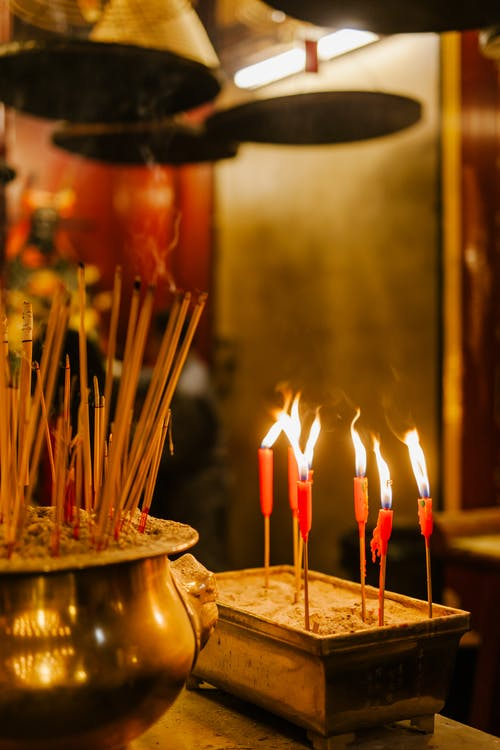 Lighted Candles on Brown Wooden Round Tray