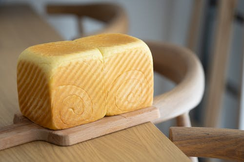 Yellow Cheese on Brown Wooden Chopping Board