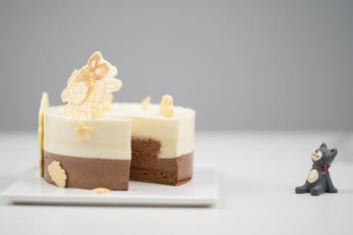 White and Brown Cake on White Table