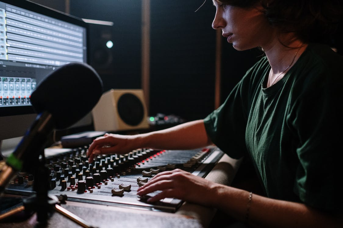 Man in Green Crew Neck T-shirt Using Computer