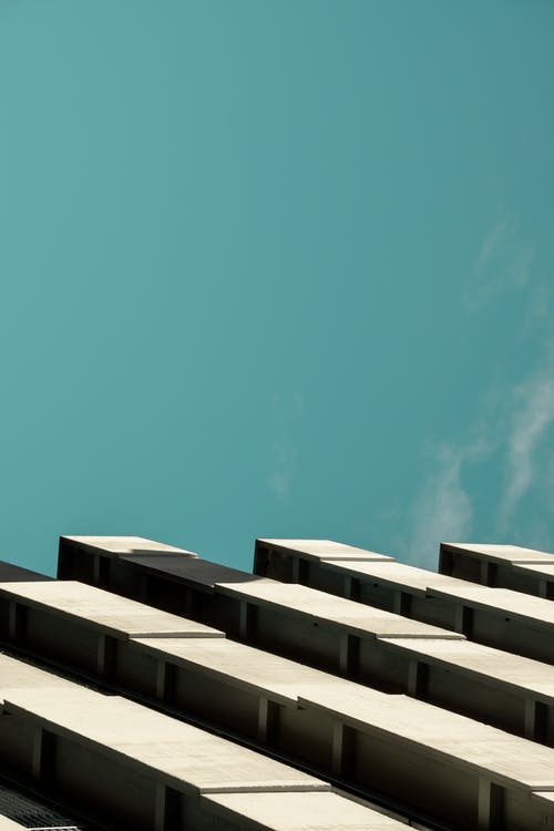 White Concrete Building Under Blue Sky