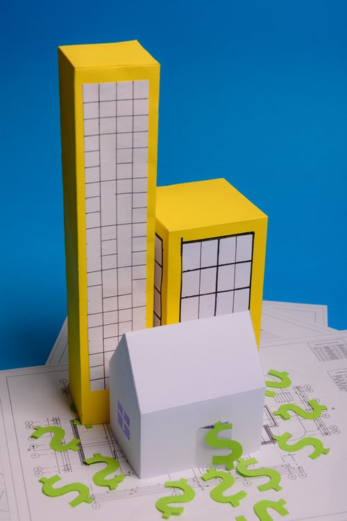 Yellow and White Building Scale Model
