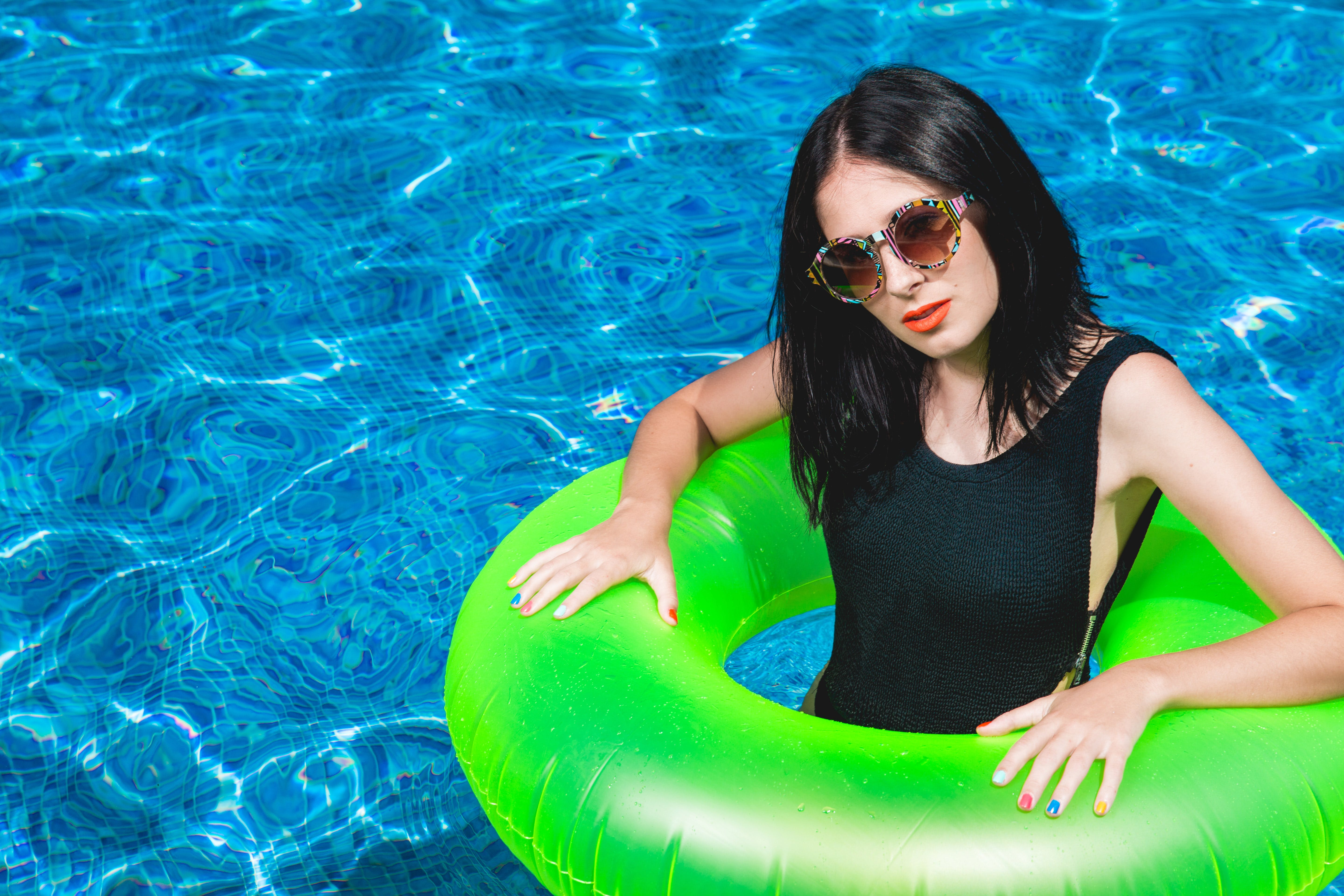 Woman in Green Pool Floater