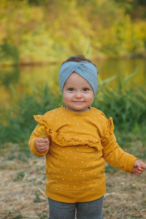 Little girl standing on lake shore