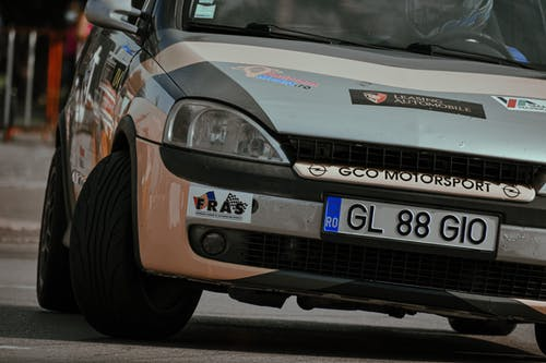Modern small car during drifting on asphalt pavement while taking part in city rally race