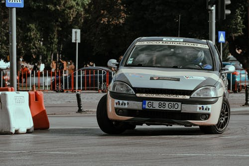 Car driving fast during rally