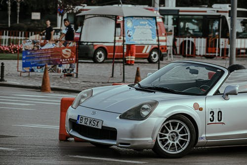 Silver cabriolet racing in city center