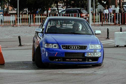 Driving race car on city street