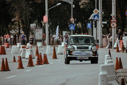 Retro car driving on street track