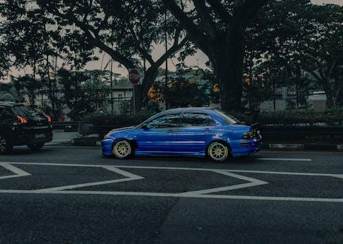 Modern blue car on asphalt road