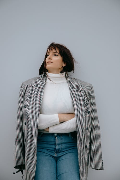 Woman in White Turtleneck Shirt and Gray Coat
