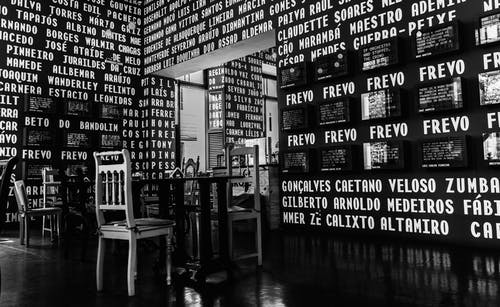 Grayscale Photo of Inside of a Restaurant