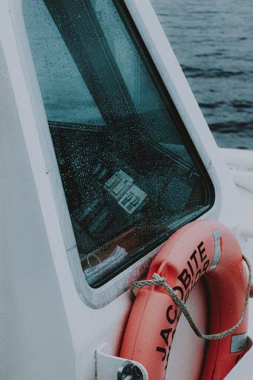 Motor boat with lifebuoy on wavy sea