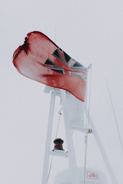 National United Kingdom flag on mast of yacht