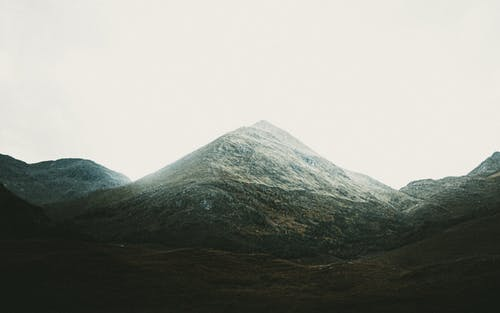 Green and Gray Mountain Under White Sky