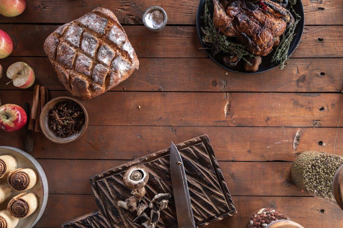 Roasted Turkey, Bread and Cinnamon Rolls on the Table