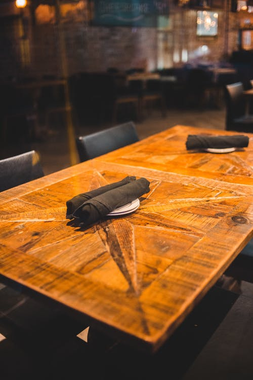 Wooden cafe table with napkins