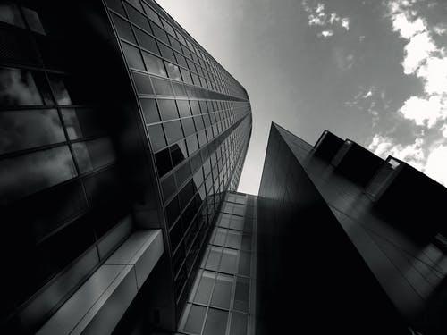 Low-angle Photography of Grayscale Building