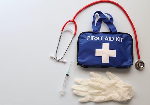Fotos de stock gratuitas de ayuda, botiquín de primeros auxilios, cuidado de la salud