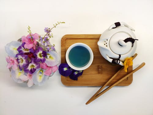 White and Blue Ceramic Mug on Brown Wooden Tray