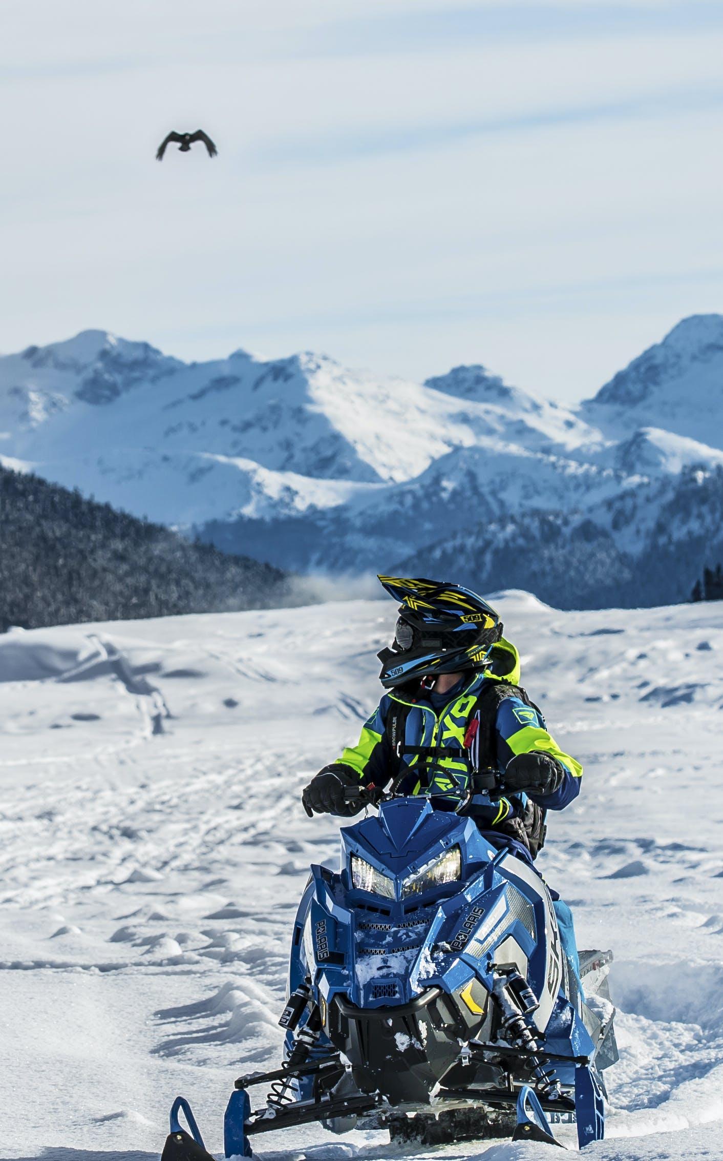 Person Riding Snowmobile