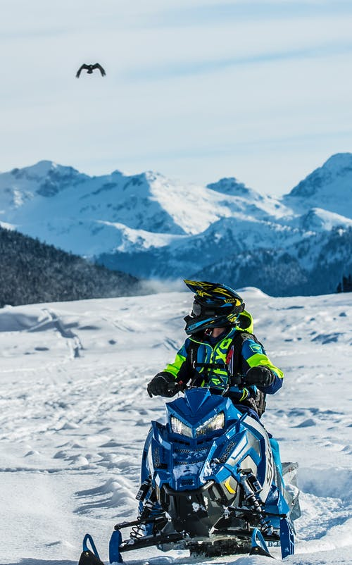 Person Riding Snowmobile