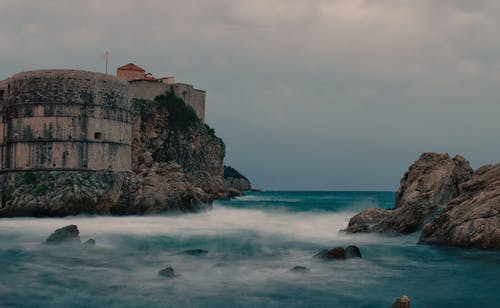Fortification on cliff washed by azure seawater