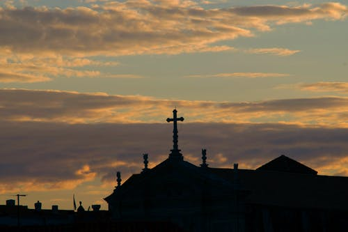 Scenery of Catholic church under peaceful evening sky