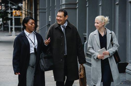 People Wearing Coats Walking