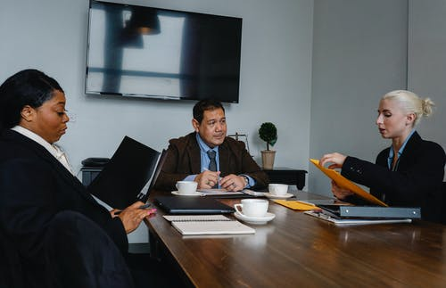 Concentrated colleagues having meeting in office