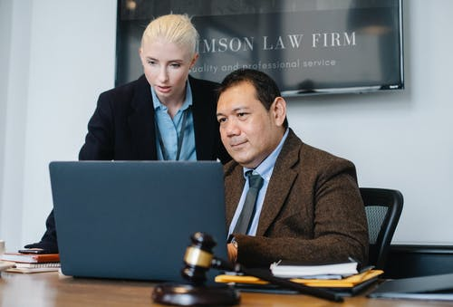 Diverse lawyers using laptop while working on new case