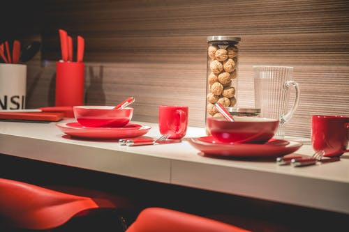 Red Dinnerware Set on Table