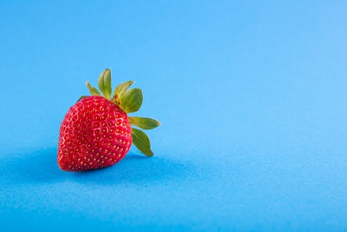 Strawberry on Blue Surface
