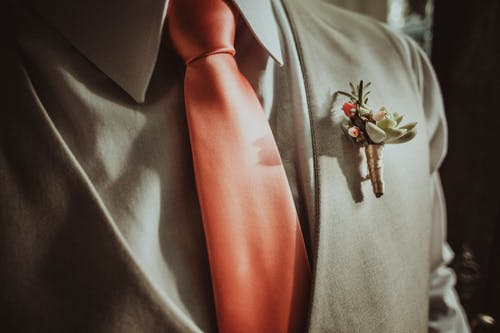 Crop man in elegant suit with boutonniere