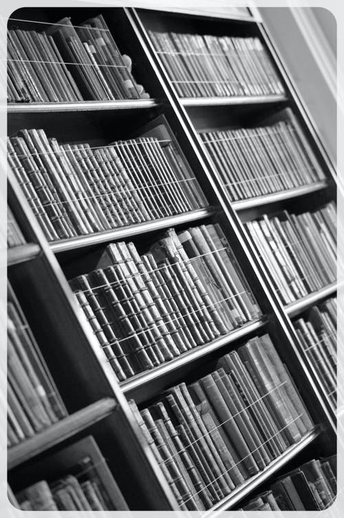 Free stock photo of black and white, books, bookshelf, library