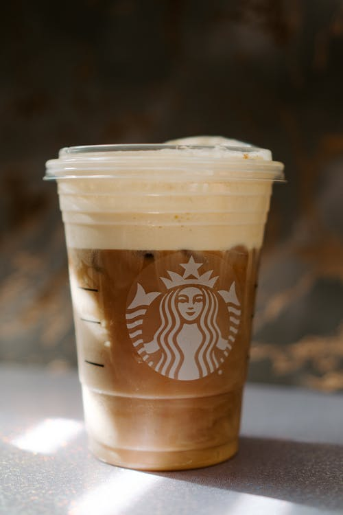 White and Brown Starbucks Coffee Cup