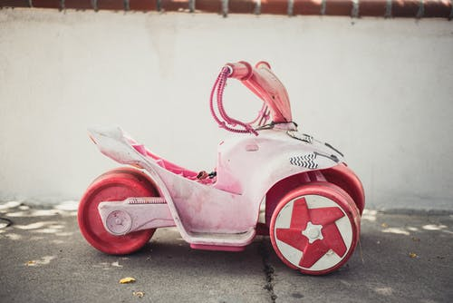 Children Pink Ride-on Toy on Road