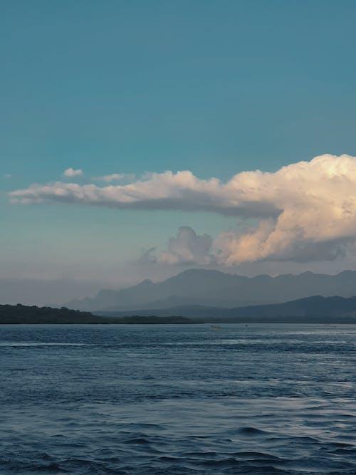 Scenery of rippling sea near hilly coast