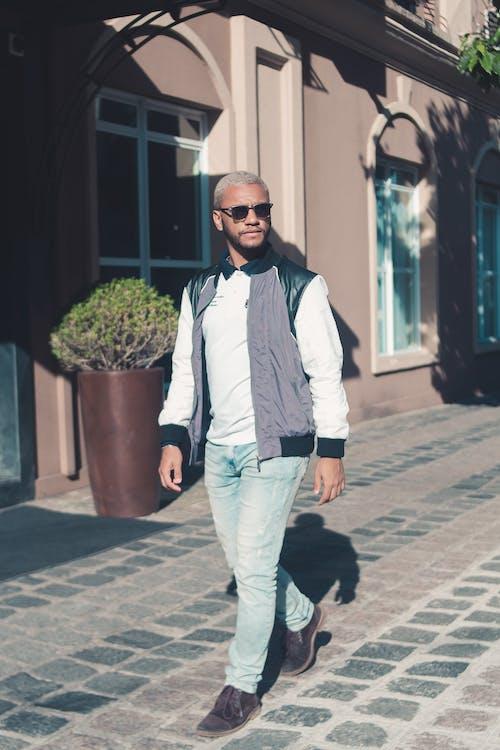 Stylish Man walking on Cobblestone Pavement