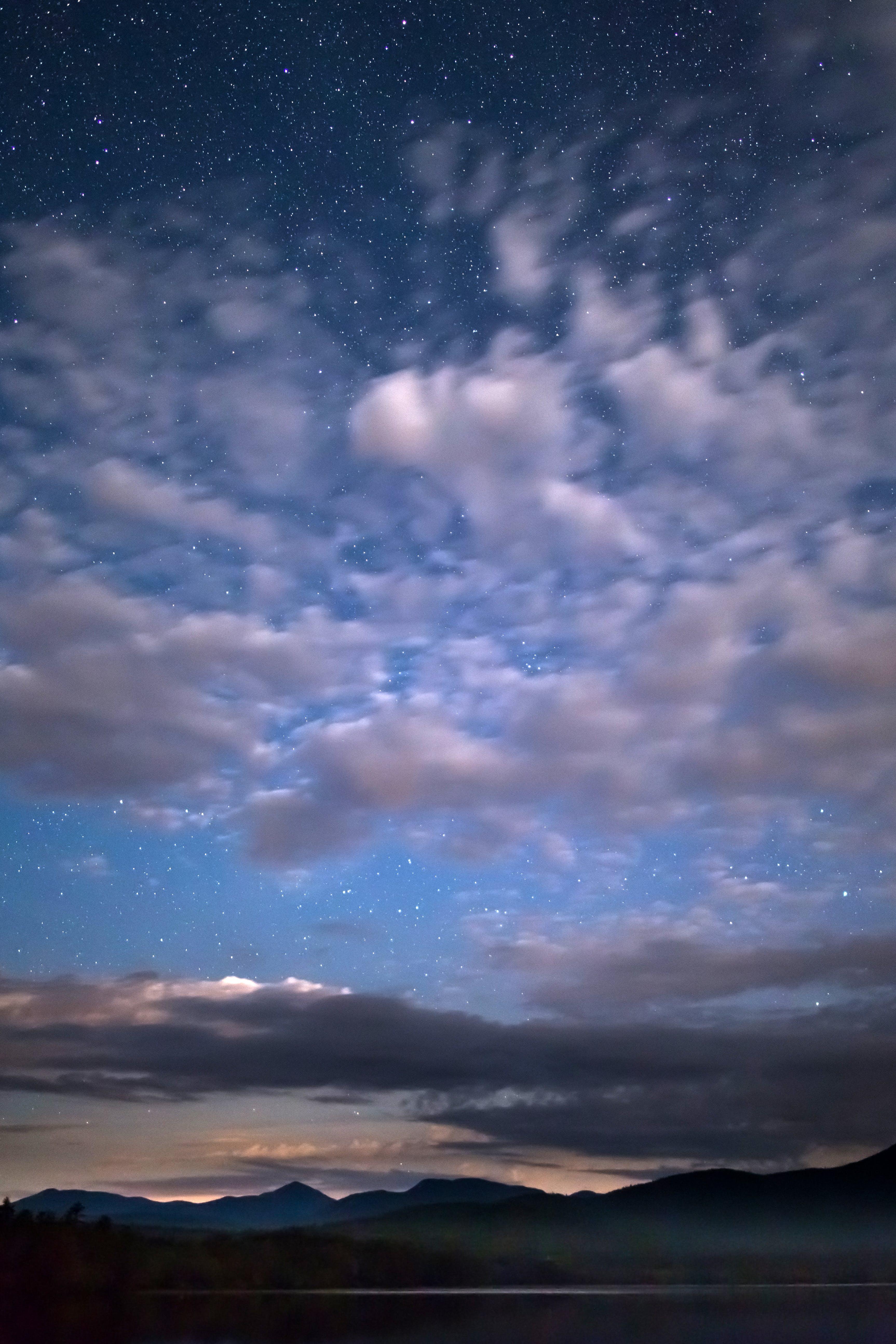 Kostnadsfri bild av bakgrundsbelyst, bergen, himmel, kändisar