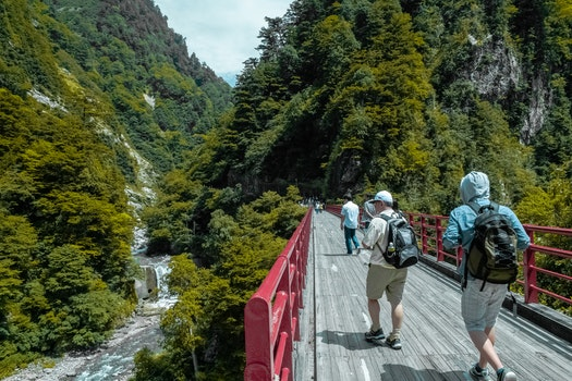 Free stock photo of mountains, people, water, bridge