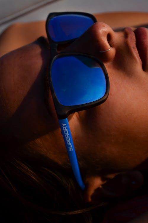Woman Wearing Blue Framed Sunglasses