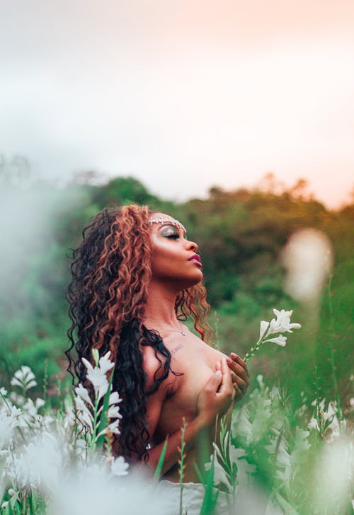 Naked woman in green field