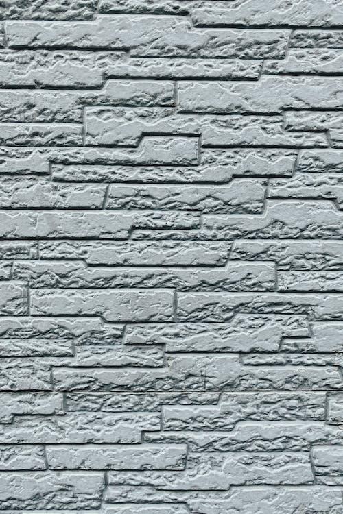 White wall with shabby bricks